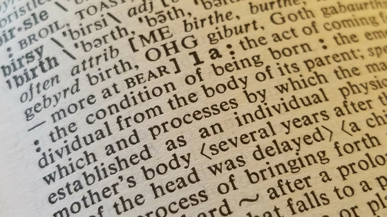 "A closeup photograph of a dictionary entry for the word, ""birth"". 